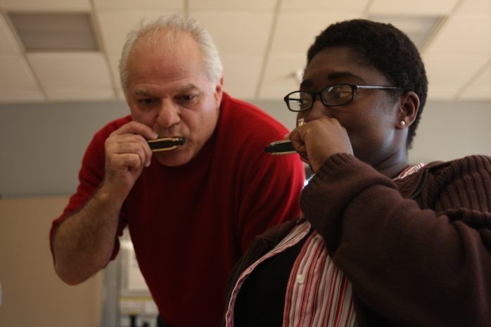 Rand De Mattei, a music instructor with Blues in the Schools, gets in tune with Petty Officer 2nd Class Tyreen S. McRae, a participant in neurologic music therapy, at Naval Medical Center San Diego Feb. 28. Neurologic music therapy helps Wounded Warriors